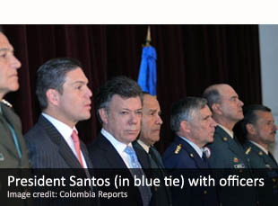 President Santos (in blue tie) with Colombian military officials