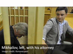 Valery Mikhailov, left, with his attorney