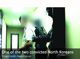 One of the two North Koreans being led to court